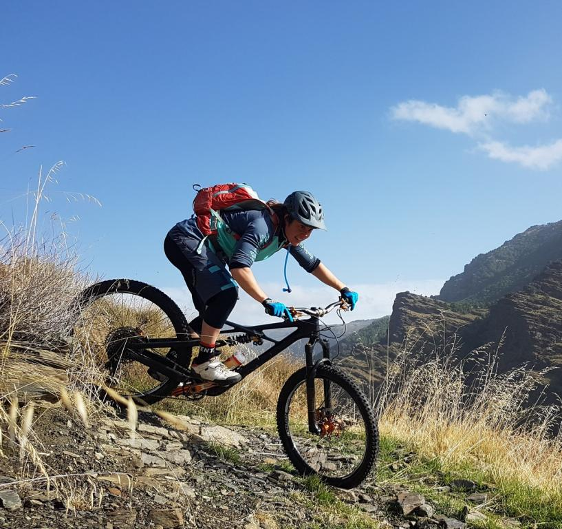 Katy Curd riding Spanish singletrack