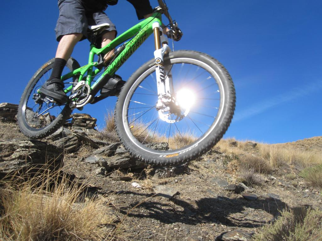 Mountain bike wheel glinting in the sun